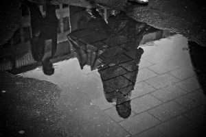 Puddle Showing Peoples Reflections